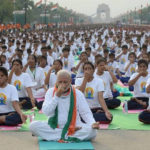 Indian Prime Minister Narendra Modi, front and center, leads tens of thousands of people in a yoga demonstration on the first IYD in New Delhi, June 21, 2015. (AFP/Getty Images)